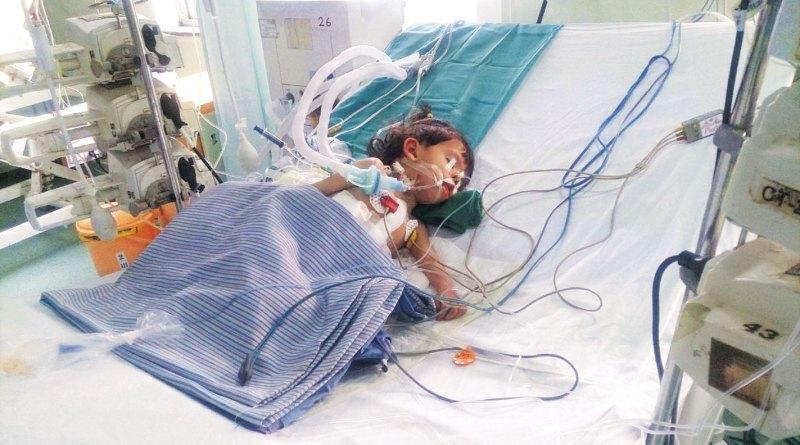 Afghan baby Aisha battles for her life.