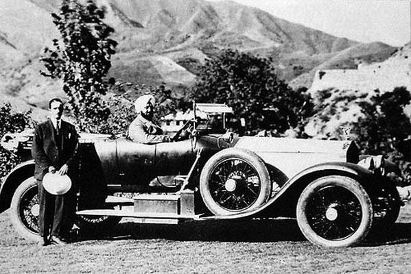 Maharaja Bhupendra Singh driving a Rolls Royce car.