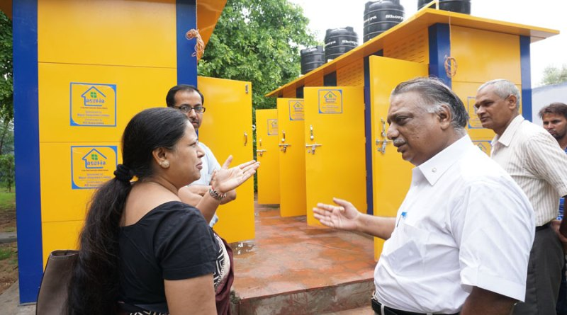 From left: Mukesh Singh, Raakhi Gupta, PDG Ramesh Agrawal and Suresh Kumar Sharma, Principal, Radhaswamibagh School, inspect the school's toilet block.