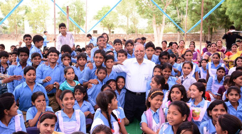 Rtn Suresh Poddar among school children, what he loves best.