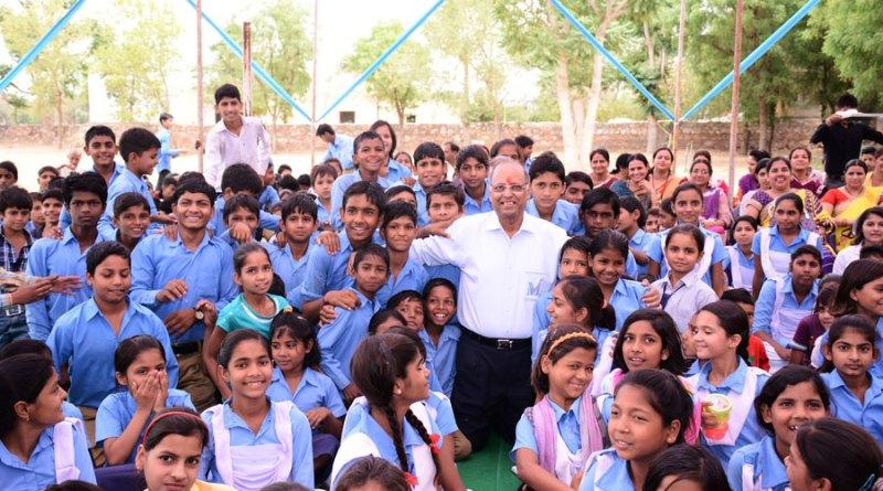 Rtn Suresh Poddar among school children, what he loves best.