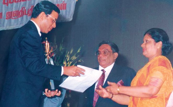 Receiving an award from Sri Lankan President Chandrika Kumaratunga.
