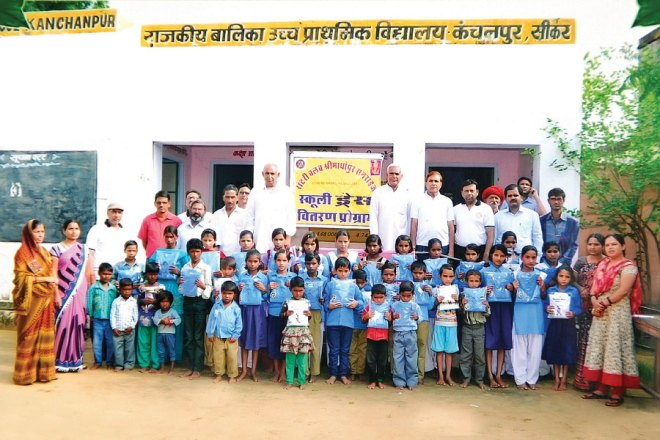 RC Srimadhopur Sunrise RI District 3052 School uniforms donated to 250 poor students from various government schools to promote literacy.