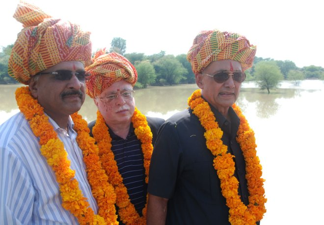 From Right: PRIP Kalyan Banerjee, TRF Trustee Sushil Gupta and PDG Ashok Gupta at the inauguration of a check dam built by Rotary in a Rajasthan village.