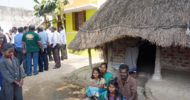 Jyothilingam and his family prepare to shift from his old thatched house to the new one.