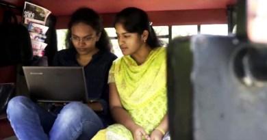 Commuters enjoying a ride in Annadurai's autorickshaw.