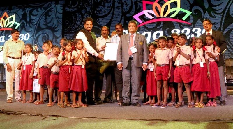 District Vocational Service Director R M Ananth (left) honours Panchayat School Headmaster Ayyappan (third from left) in the presence of DG Natarajan Nagoji.