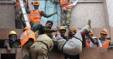 Firefighters rescue a man from a fire accident at the AMRI Hospital, Kolkata.