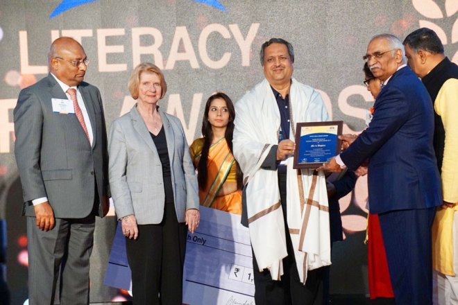 RSALS Chair J B Kamdar hands over the Literacy Hero Award to Aspire's Secretary Dayaram in the presence of Judy Germ and RIDE C Basker.