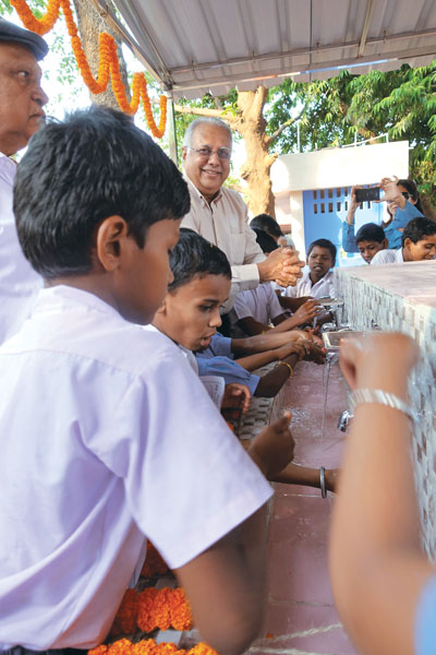 RI Director Manoj Desai inaugurates a group handwashing station.