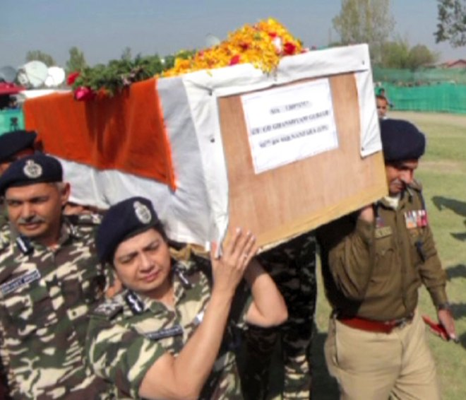 Lending a shoulder to a cadre killed by militants