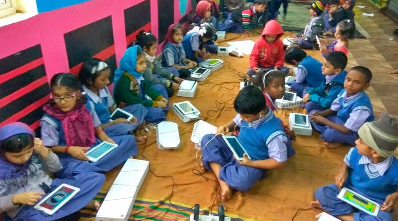 Children engrossed in learning their lessons with the MKD Tablets.