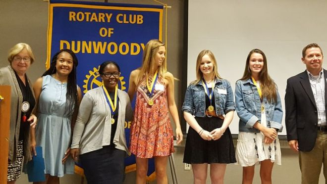 L to R: Tina Philpot, Rotary President; TeNesha Ukomadu, Dunwoody High teacher; Gratia Uzizeye 10th grade; Sara Jane Borcherding. 9th grade; Jordan Hope, 12th grade and school winner; Riley Park, 11th grade; Principal Tom McFerrin.