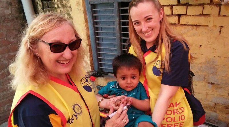 Dianna and Danelle Wilson hold one of the many children that received oral polio vaccine during their trip to India.