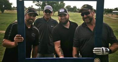 The golf tournament's first-place team of, from left, Cody Burke, Roger Marshall, Brandon Jackson and David Burke.