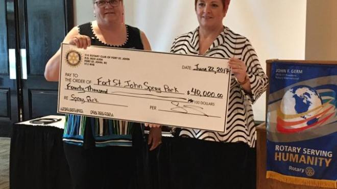 Fort St John Rotary Club President Donna Greenway presents Mayor Lori Ackerman with a $40,000 cheque towards Spray Park upgrades.
