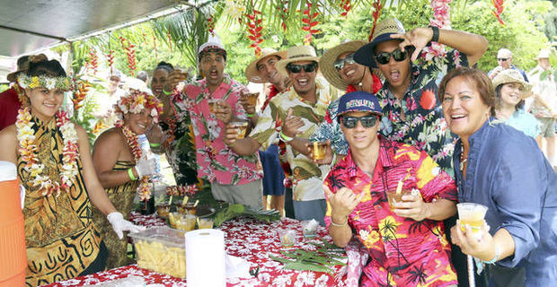 The Aloha Crew has fun waiting for mai tai at the Tahiti Nui stand during the 29th annual Taste of Hawaii hosted by the Rotary Club of Kapaa at the Smith's Tropical Paradise. Photo: Dennis Fujimoto