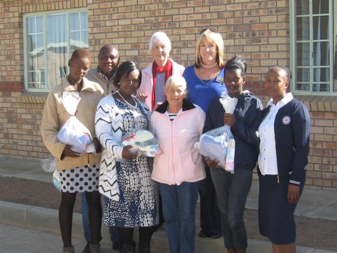 Rotary Club and Unisa Social Work Department handed over birth packs at Ga–Kolopo Village. In the front (from left) is Pontsho Rasekgala (beneficiary), Phuti Kanama (Unisa Student), Marlene Swart (Rotary Club), Ngoakoana Raletjana (beneficiary) and Segale Mmmutlana (Mentor Mother). At the back is Unisa Supervisor Brian Tigere and Rotarians Babbie Wheelwright and Yvonne Joubert.