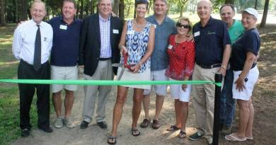Fort Mill Rotary Club member Susan Fuller cuts the ribbon to officially open Rotary Way at the Anne Springs Close Greenway on June 31. Photo: Andrew Stark