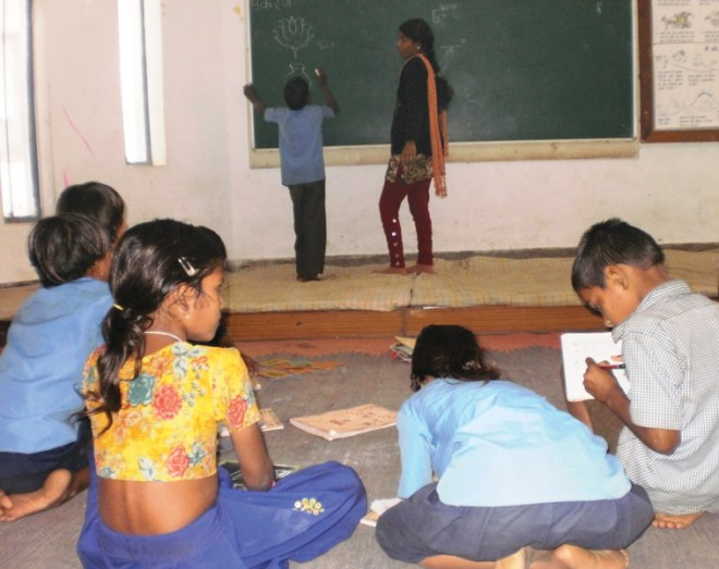 Busy with their lessons at school, braving all odds.