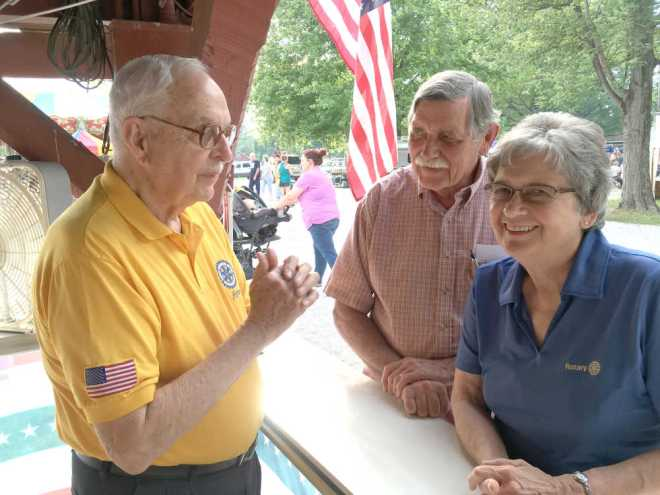 Amos Thomas chats with Rotary District Governor Judy Bush and her husband John during the '4th of July' celebration at Forest Park in Brazil. Photo: Frank Phillips