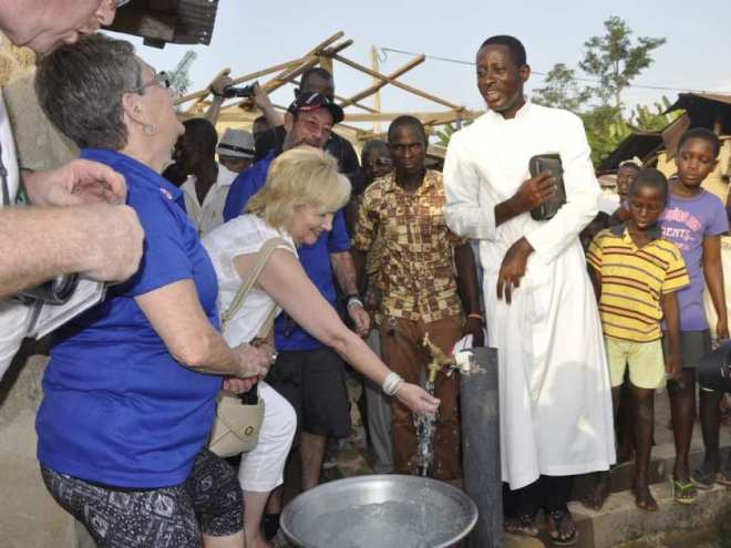 Windsor's Kim Spirou, centre, samples water from a well in Ghana, November, 2016. The Rotary of Club of Essex is recruiting volunteers for its next humanitarian mission to Ghana to help dig wells, rebuild a school and hand out mosquito nets in November.