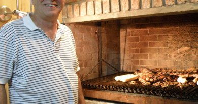 Osvaldo prepares the barbecue in Buenos Aires.