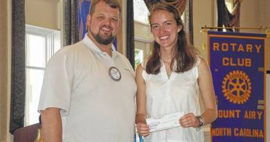 Anna Ilyasova receives a $1,000 Rotary scholarship from Matt Edwards, past president of Mount Airy Rotary Club.