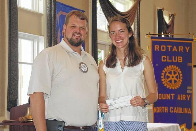 Anna Ilyasova receives a $1,000 Rotary scholarship from Matt Edwards, past president of Mount Airy Rotary Club.