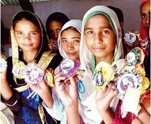 Girls from Haryana's Marora, popular as Trump village, with their Trump Rakhis on Saturday.
