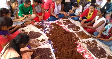 Children making seed balls.