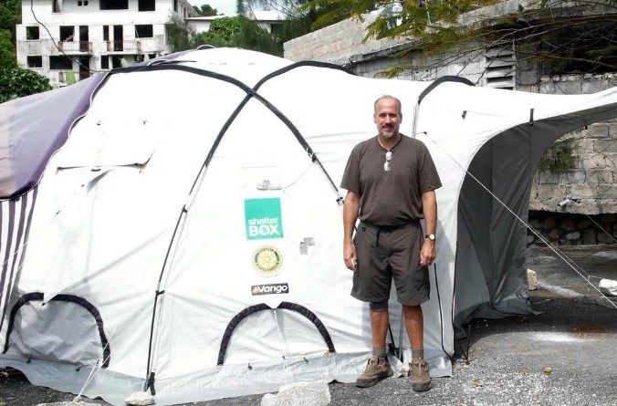 Concord Rotarian Paul D'Oliveira with a Rotary-sponsored ShelterBox tent after an earthquake in Haiti.
