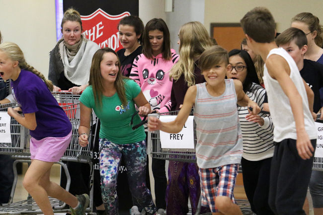 Students of Grande Prairie Christian School take off in a race to fill their carts with food donations in the Eastlink Centre Fieldhouse on Thursday in Grande Prairie. The event was a kick-off for the Rotary Club's food drive.  Photo: Kevin Hampson/Daily Herald-Tribune