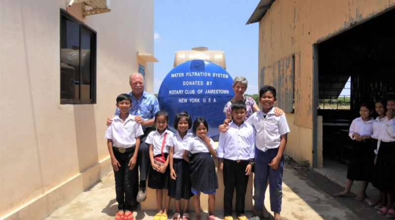 Rotarians David and Marissa Troxell with students at Camobida Academy after completion earlier this summer of the new filtration system. Photo: Submitted