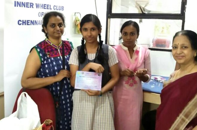 Nalini Prabhakar (right), former Chairman of Inner Wheel District 323, with a school student who was vaccinated for rubella.