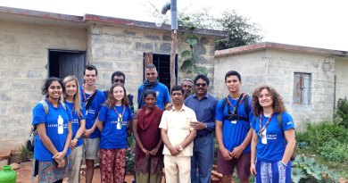 Rotarians with the Liter of Light team after installing a solar street lamp in the village.