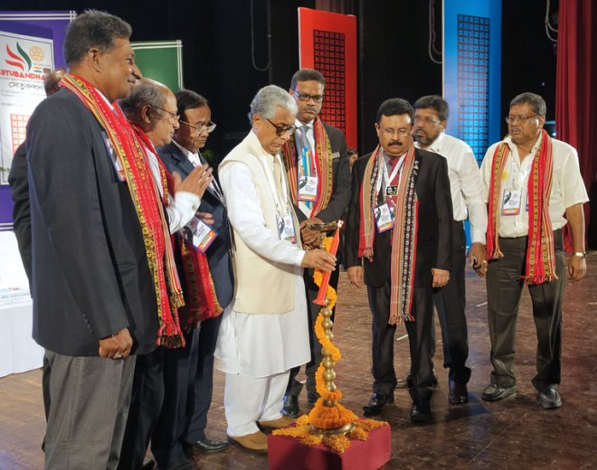 Tripura Chief Minister Manik Sarkar lights a lamp to inaugurate the International Conference Setubandhan. On his left are RI District 3282 DG Tayub Chowdhury and RI District 3240 DG Sunil Saraf; and on his right Bangladesh Railway Minister Mazibul Hoque and RC Agartala City President Dr S K Banik.