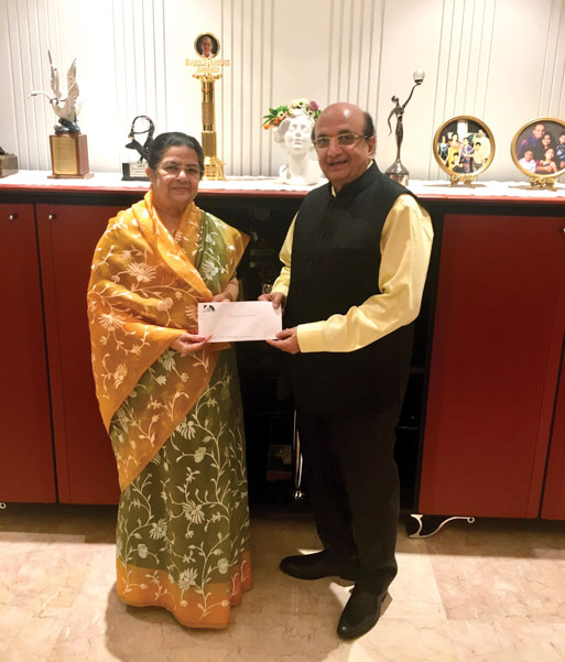 PRID Ashok Mahajan receives cheque for Rs 50 lakh from Rajashree Birla, Chairperson, Aditya Birla Foundation for Community Initiatives and Rural Development.