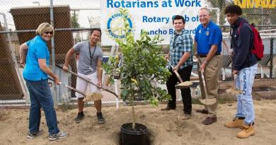 Judy Lutticken (Rotary project manager), Raphael Magante, Seth Francis, Mike Fugua (Rotary president) and Julien Bing plant one of the trees. Photo: James Kaspar