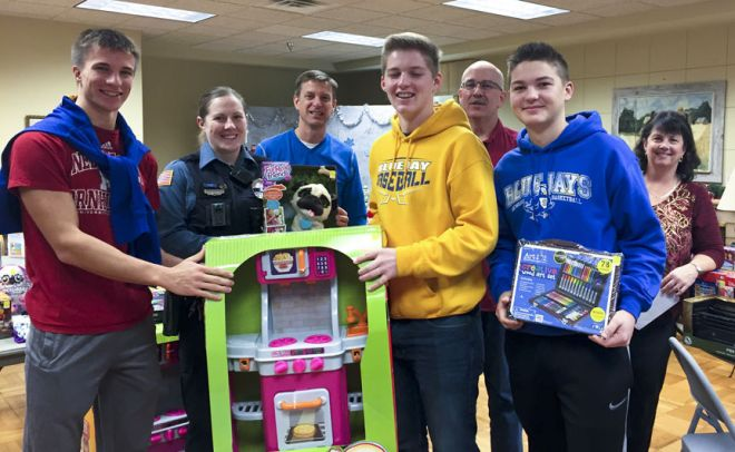 Representatives from the Seward Police Department and Seward Rotary Club to sort and organise toys from Stuff the Cruiser for parents to pick up. They were invited to select the toys their children would receive for the holiday from the donations received. Courtesy photo