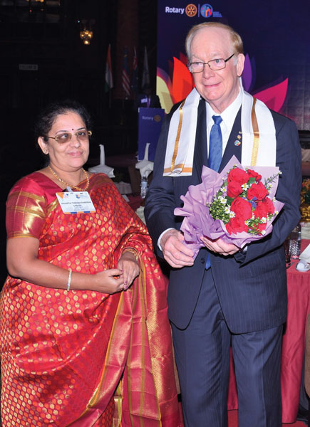Vasanthi Theenachandran welcomaes TRF Trustee Chair Paul Netzel with a bouquet at the KL Zone Institute.
