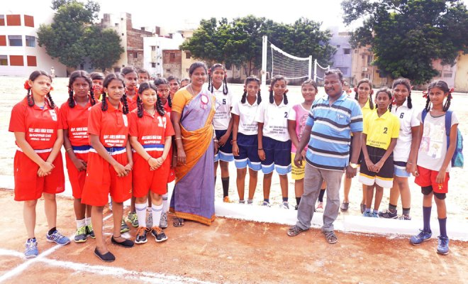 Students along with physical education trainers R Selvi and D Ramesh Babu at the Government Girls High School in Mogappair.