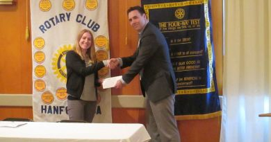 Darcey Pickens accepts a grant from Rotary Club of Hanford President Thomas Davis on behalf of Champions recovery organisation.   Photo: Julissa Zavala/The Sentinel