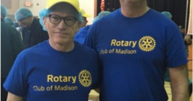 Project chair Ellsworth Havens (left) and Madison Mayor Bob Conley helped pack more than 120,000 meals at last year's End Hunger event. Photo: TAPinto Madison