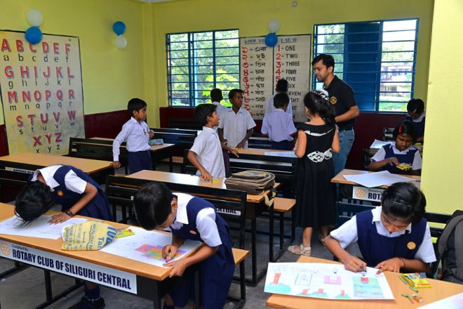 Students absorbed in an art competition organised by the Rotarians.