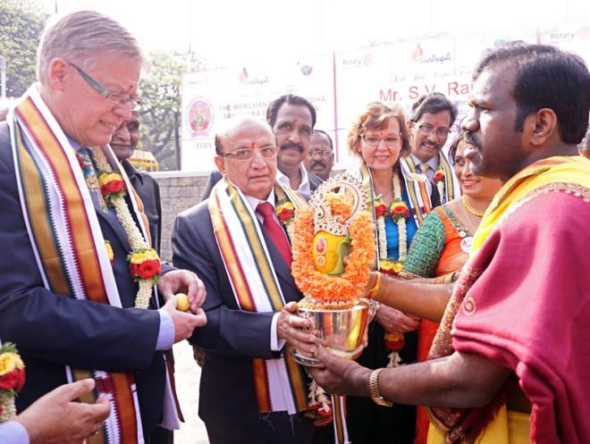 RID Mikael Ahlberg, PRID Ashok Mahajan and Charlotte Ahlberg being given a traditional welcome. DG K Madhuprasad, DGND Chinappa Reddy are also present.