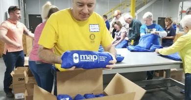 Erik Nesteruck, a member of the Rotary Club of Camden County, packs medical supplies at MAP International. Photo: Submitted