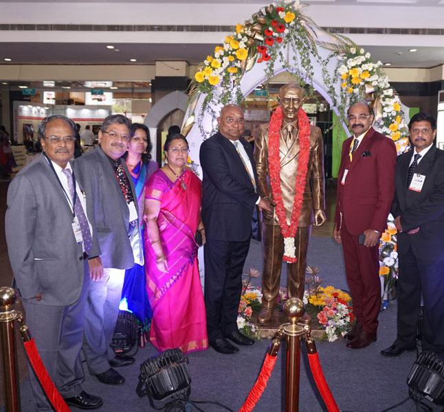 From L: DGN G Chandramohan, PDG Natarajan Nagoji, Kamala Selvam, Mala Basker, RID C Basker, Conference Chairman P R Selvam Alagappan, Rtn Raghavendra Rao with the statue of Rotary Founder Paul Harris.