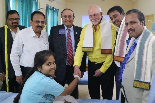 RIPE Barry Rassin greeting a girl at the thalassaemia block of the Rotary Blood Bank at the VHS Hospital. Also seen are (from left) RPIC Rajadurai Michael (Zone 5), Rtn Dr P Srinivasan, PRID PT Prabhakar, DG R Srinivasan and DGE Babu Peram.