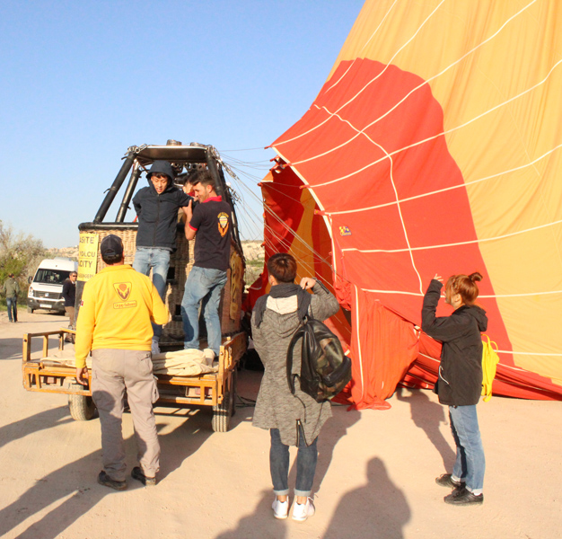 The wicker basket makes a gentle landing on the pick-up truck and passengers are helped to alight.